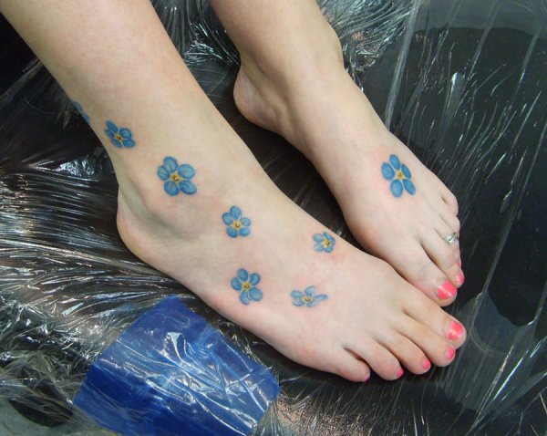 Blowing cute forget me not flower pattern tattoo