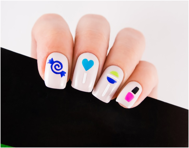 Cute Nail Designs With Blue Black Green And White Color On Pink Nail