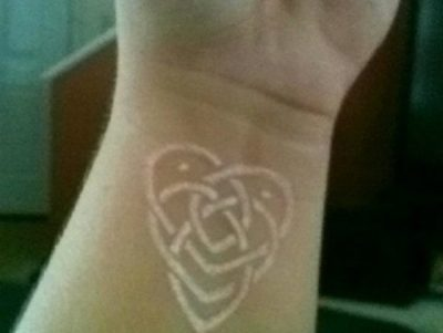 white ink hearts tattoo on wrist