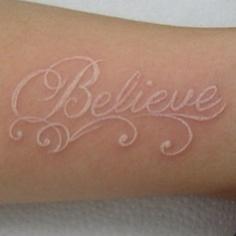 white ink tattoo believe