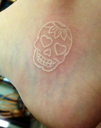 white sugar skull tattoo