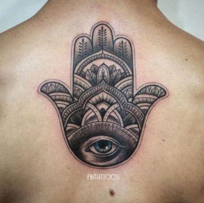 hamsa hand tattoo on back