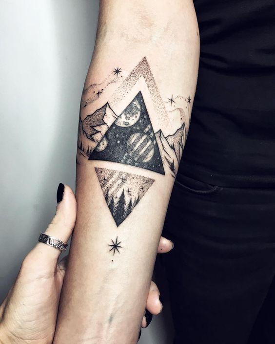 winter season crescent moon and sun earth tattoo design