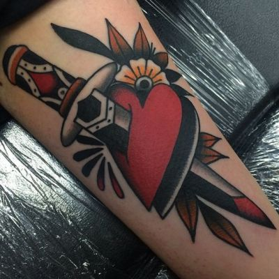 traditional heart and dagger tattoo