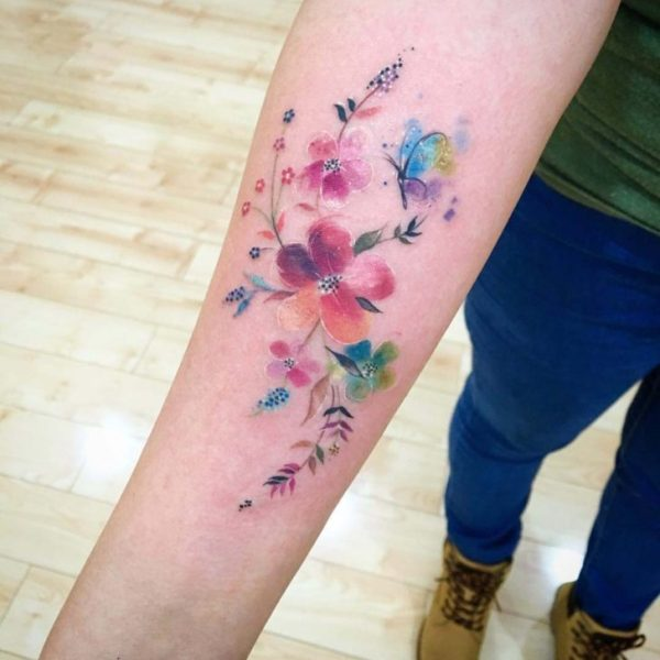 Feminine Colorful Floral Tattoo on forearm