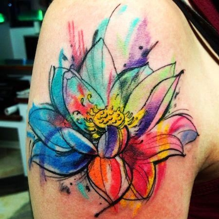 big colorful flower tattoo on half sleeve