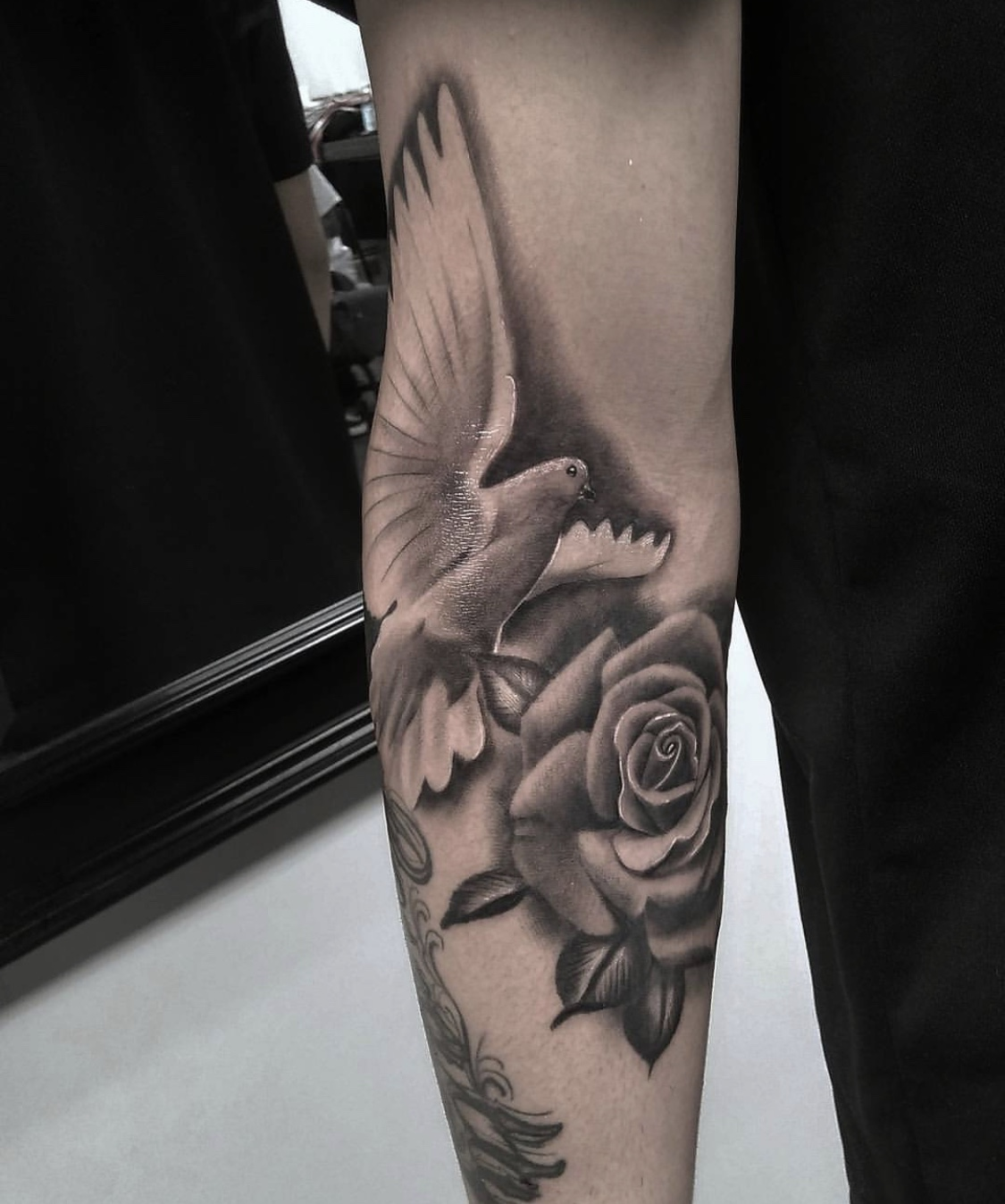 Black And White Dove With Rose Tattoo On Arm Entertainmentmesh