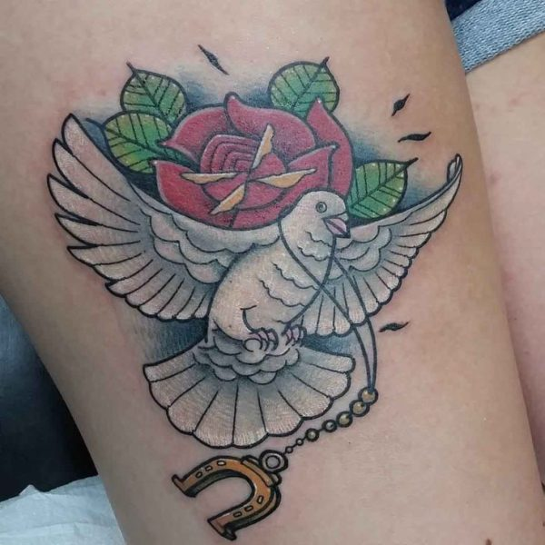 dove and rose with magnet tattoo