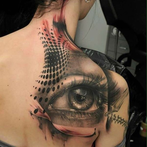 realistic big female eye polka trash tattoo on shoulder blade