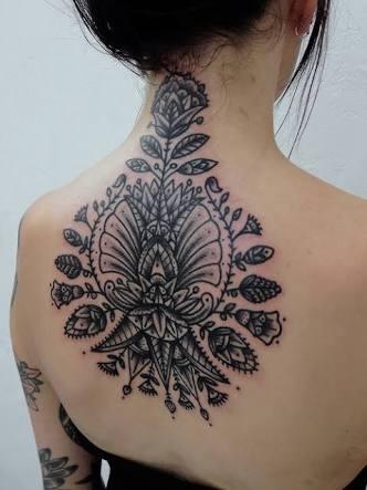 tribal floral pattern tattoo design on back