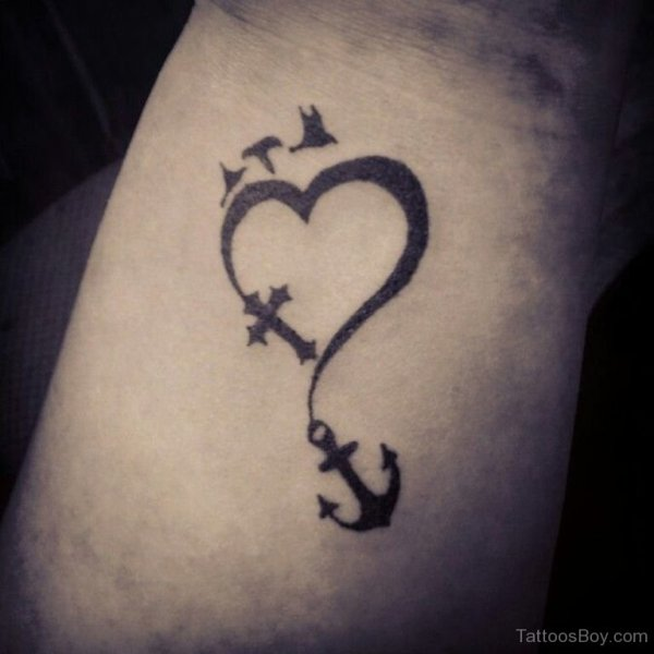 anchor cross heart tattoo with flying birds on wrist