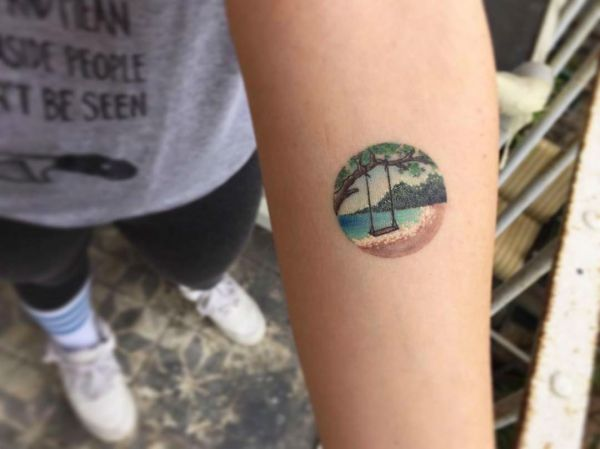 beach and rope swing tattoo picture
