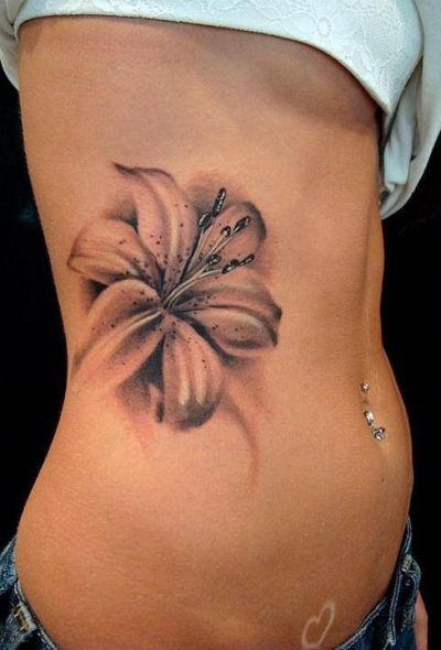black and grey tiger lily tattoo on ribs