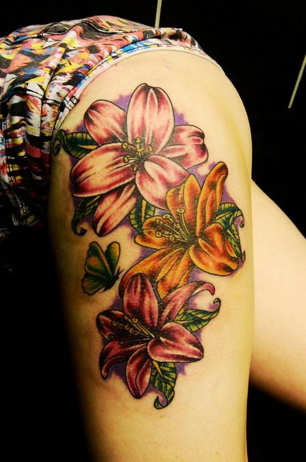 colorful tribal tiger lily flower tattoos with butterfly on side thigh