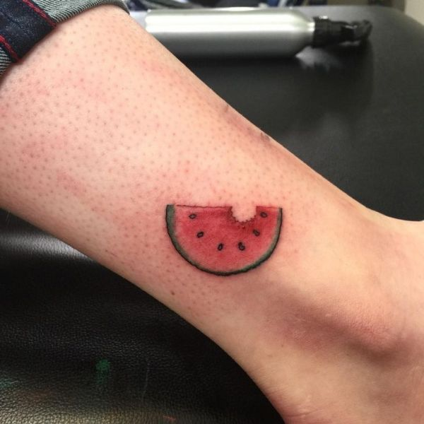 water melon tattoo on side ankle