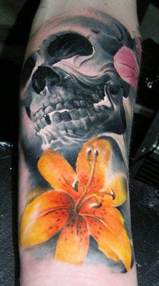 yellow tiger lily tattoo with dark skull