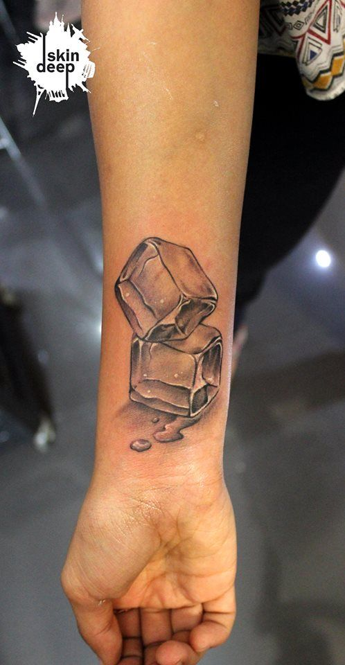 black ink ice cube tattoo on wrist