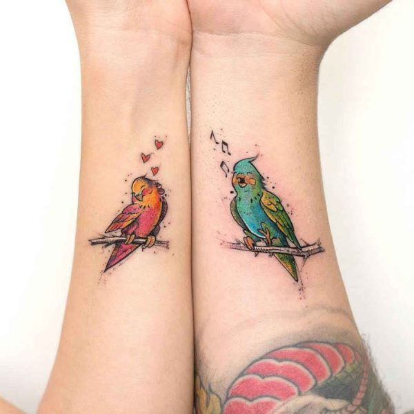 cute colorful love bird tattoos for couples on wrists