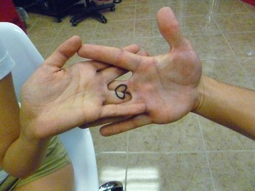 heart tattoo on inner fingers for love partners