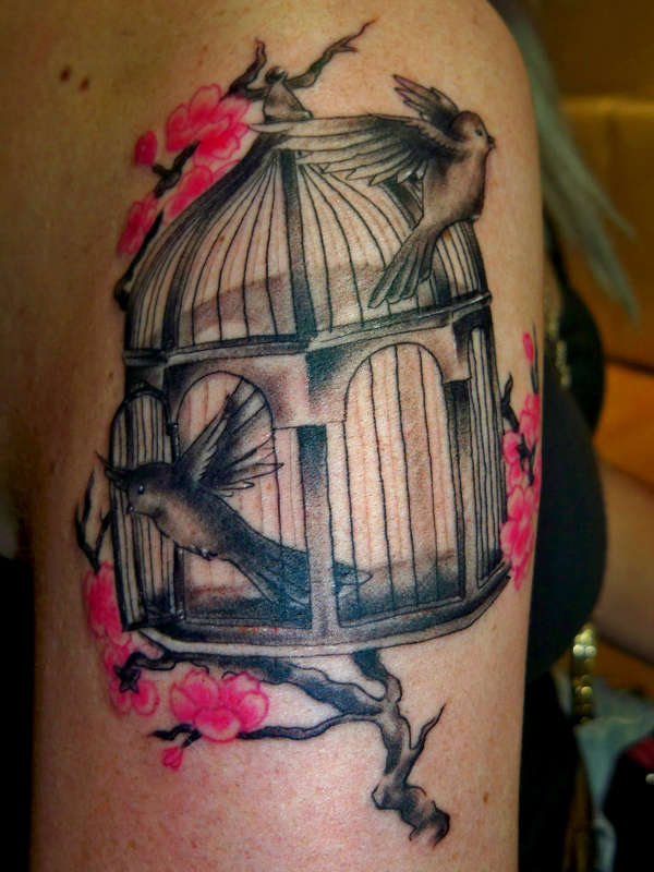 lovebirds flying out of cage tattoo