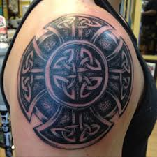 celtic interlocking patterns of knots shield armor tattoo