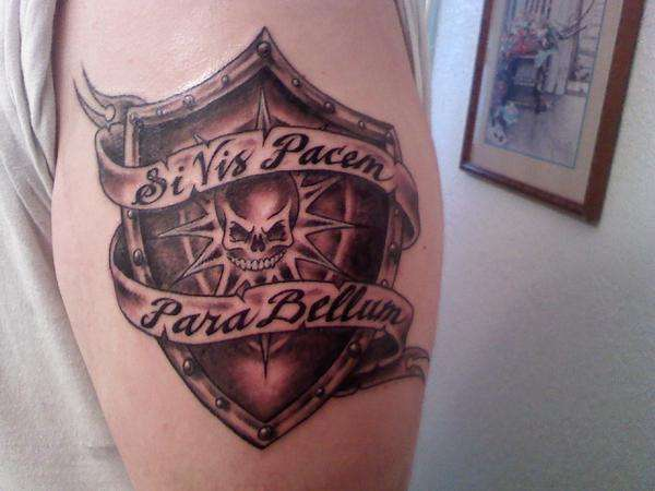 shield tattoo on upper sleeve