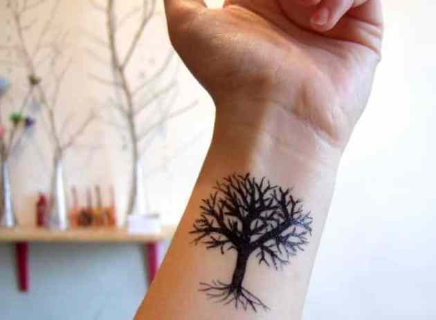black-inked bodhi tree tattoo on wrist