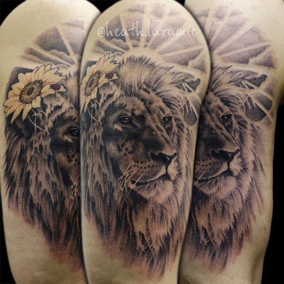 lion with sunflower upper sleeve men tattoo