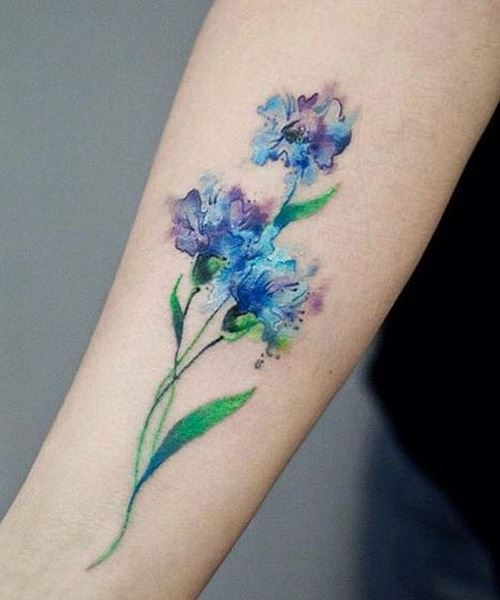 attractive watercolor flower tattoo on forearm