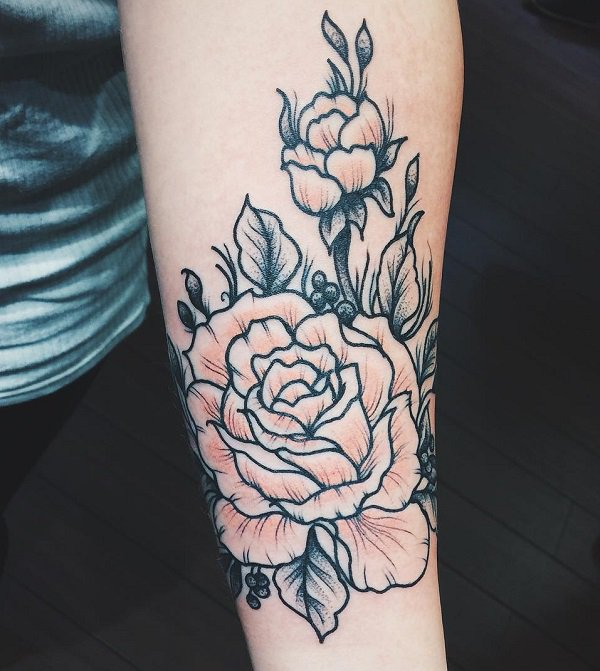 outline rose flower tattoo on forearm