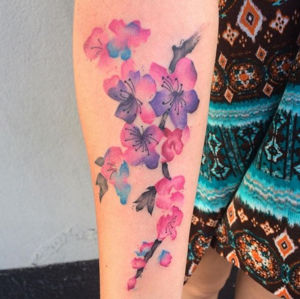 watercolor Georgia flower branch tattoo on forearm