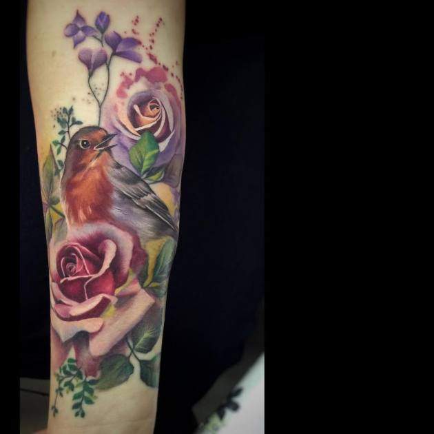 watercolor ink sparrow and roses flower tattoo on forearm