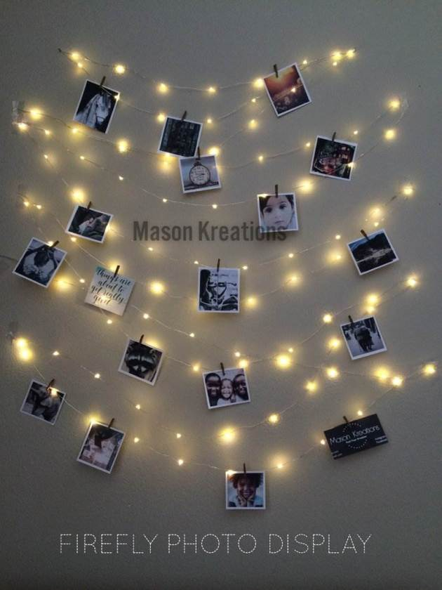 living room hanging photos on wall with lights