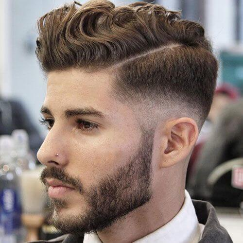 low fade wavy textured hairstyle