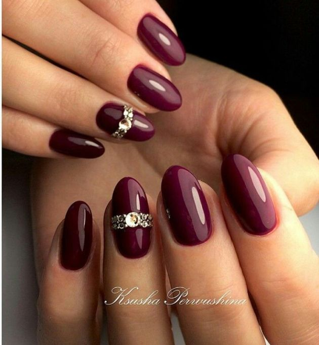 maroon nails with diamonds on one finger