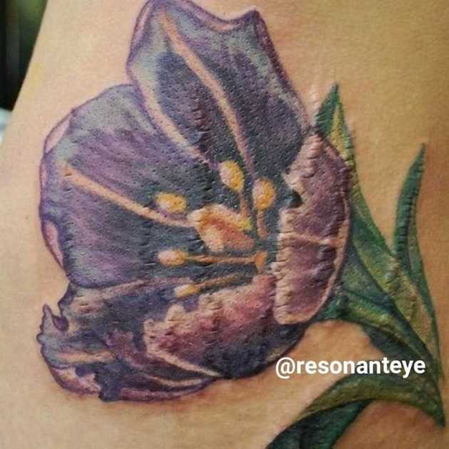 stomach stretch marks cover-up flower tattoo