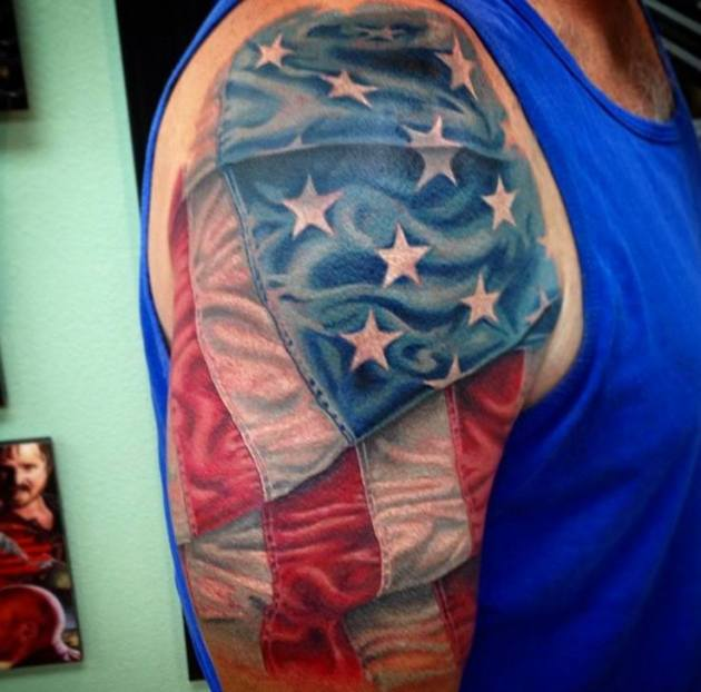 waving american flag tattoo design for men upper sleeve