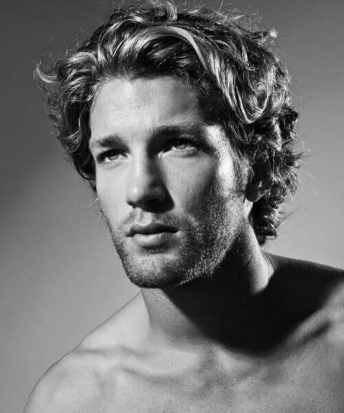 wavy medium length hairstyle for men