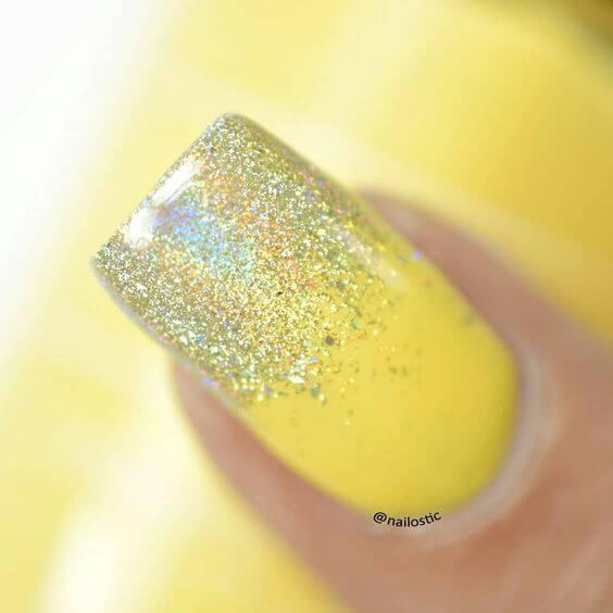 yellow nail manicure with glitter
