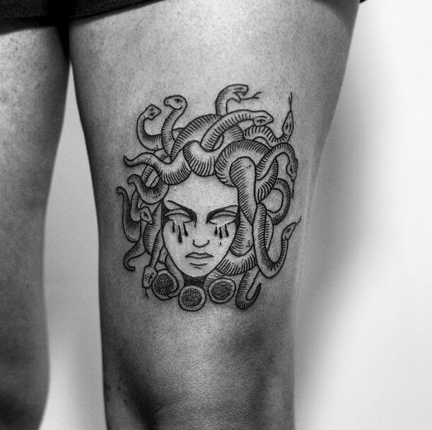 little medusa head tattoo on thigh
