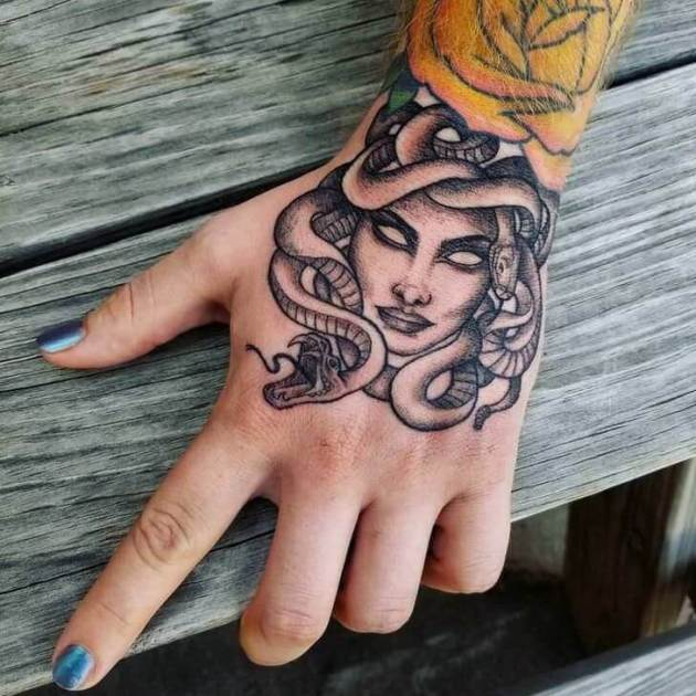 traditional medusa tattoo on hand