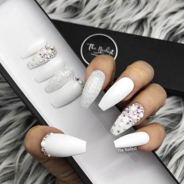 acrylic white coffin nails set with glitter and rhinestones