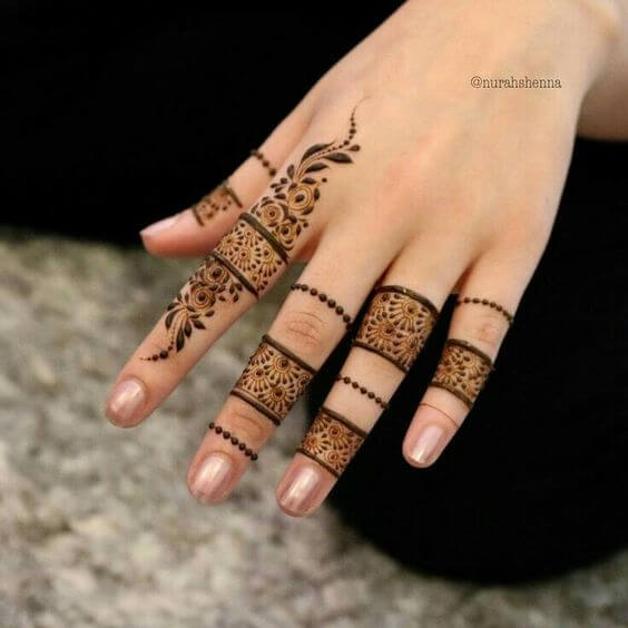 new floral henna ring designs on fingers