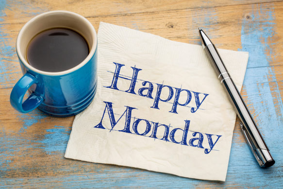 Happy Monday –  cheerful handwriting on a napkin with a cup of c