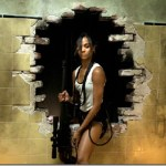 Zoe Saldana shows off her big guns in Columbiana