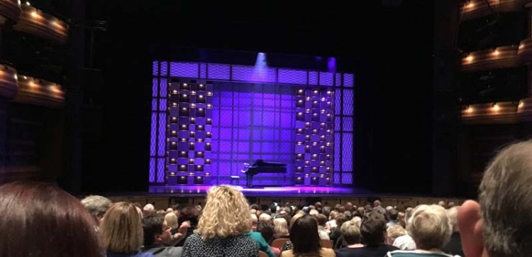 The Grand Piano ready for the beginning of Beautiful - The Carole King Musical at Wales Millennium Centre .