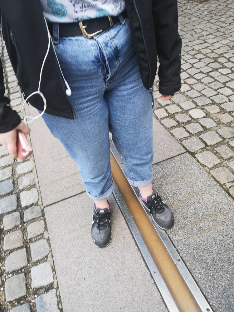 Selfie time for Seren on the Meridian Line, an attraction at The Royal Observatory. Photo: Rachel Howells.