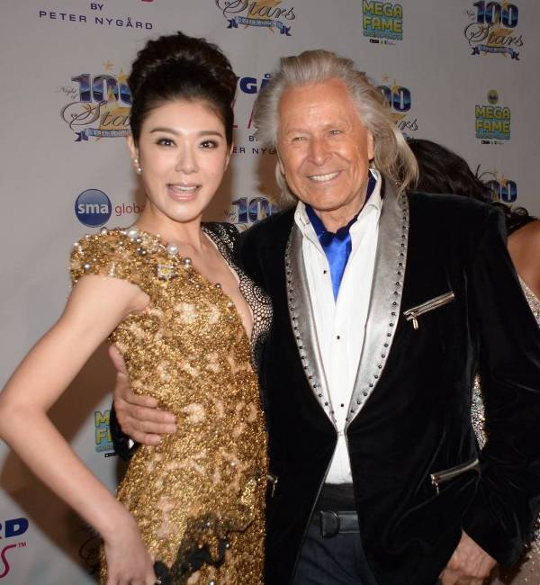 Billionaire Clothing Designer, Peter Nygard with gorgeous gal pal (Photos by Glenn Lipton)