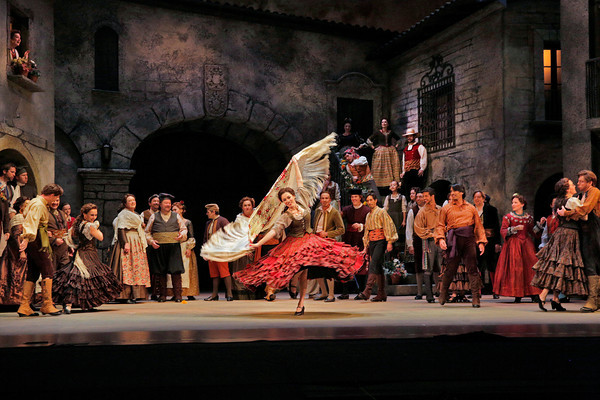A Spanish courtyard scene from San Diego Opera's DON QUIXOTE, April 2014. Photo copyright Ken Howard.