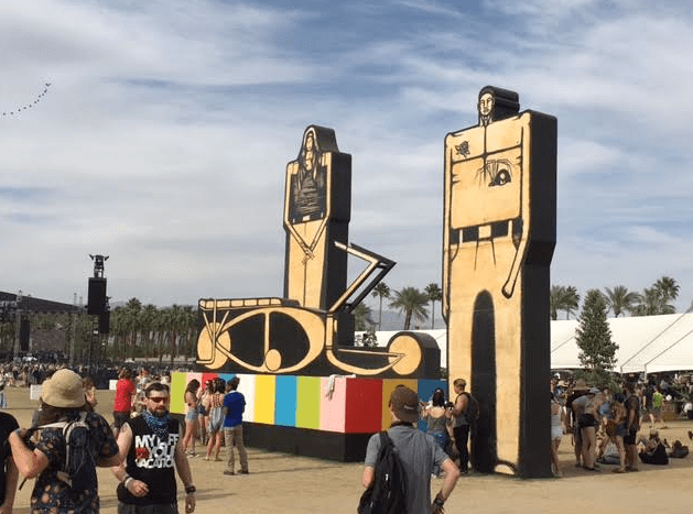 """Art is an important part of music festivals, going back to Woodstock Music & Art Fair. This piece is called """"Sneaking Into the Show,"""" a clever installation by local artist Date Farmers."""